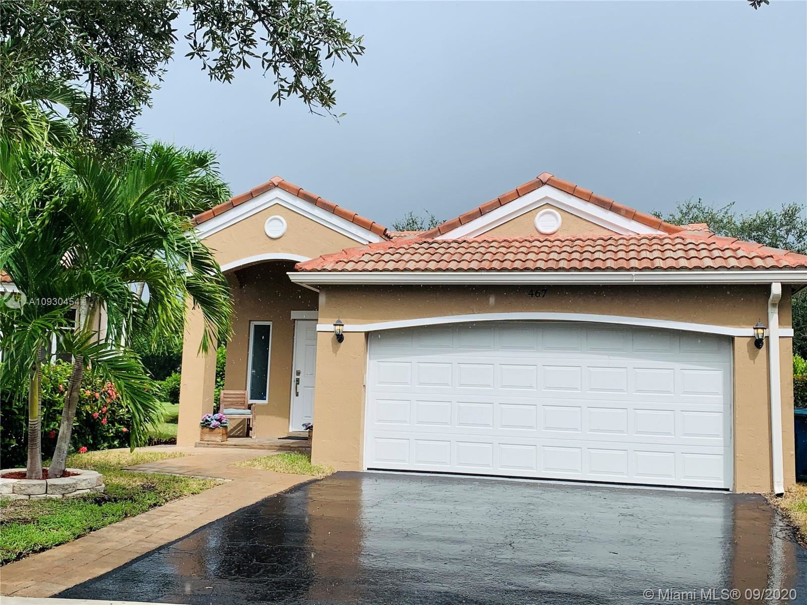 Photo of 467 Talavera Rd, Weston, FL 33326 (MLS # A10930454)