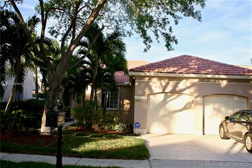 Photo of 1450 Camellia Cir, Weston, FL 33326 (MLS # A10839457)