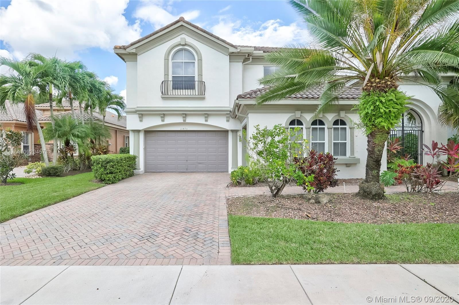 Photo of 11475 NW 75th Mnr, Parkland, FL 33076 (MLS # A10929457)