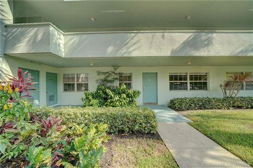 Photo of 903 Cypress Grove Dr #103, Pompano Beach, FL 33069 (MLS # A11077460)