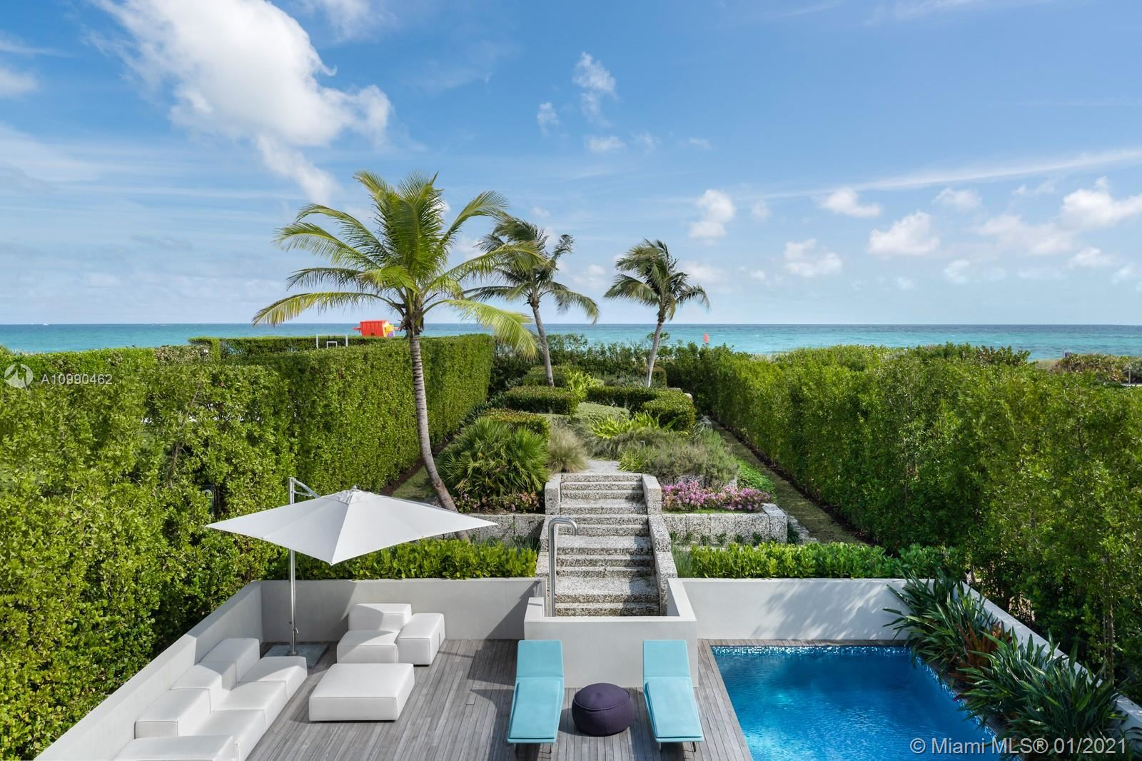 Photo of 7709 Atlantic Way, Miami Beach, FL 33141 (MLS # A10990462)