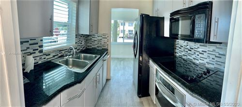 Photo of 2061 NW 81st Ave #611, Pembroke Pines, FL 33024 (MLS # A10840463)