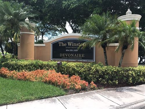 Photo of 620 SW 111th Ave #302, Pembroke Pines, FL 33025 (MLS # A11057466)
