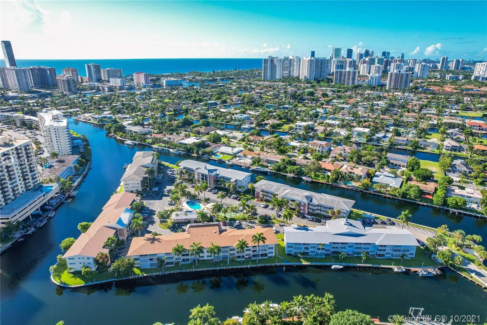 Photo of 455 Paradise Isle Blvd #105, Hallandale Beach, FL 33009 (MLS # A11109466)