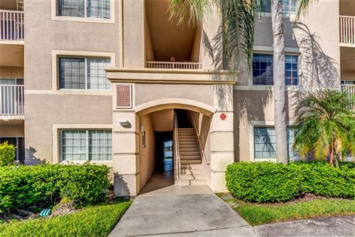 Photo of 5005 Wiles Rd #308, Coconut Creek, FL 33073 (MLS # A10734471)