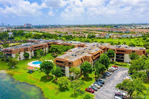 Photo of 671 NE 195th St #119E, Miami, FL 33179 (MLS # A10904473)
