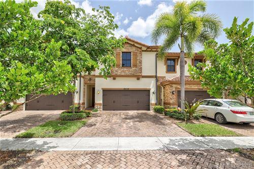 Photo of 8448 Blue Cove Way, Parkland, FL 33076 (MLS # A11093473)