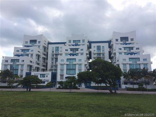 Photo of 7600 Collins Ave #714, Miami Beach, FL 33141 (MLS # A10750474)