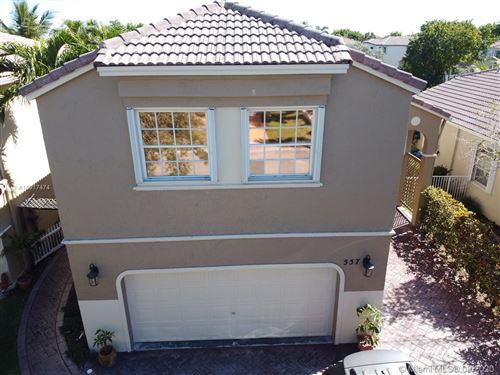 Foto de inmueble con direccion 557 NW 159th Ave Pembroke Pines FL 33028 con MLS A10917474