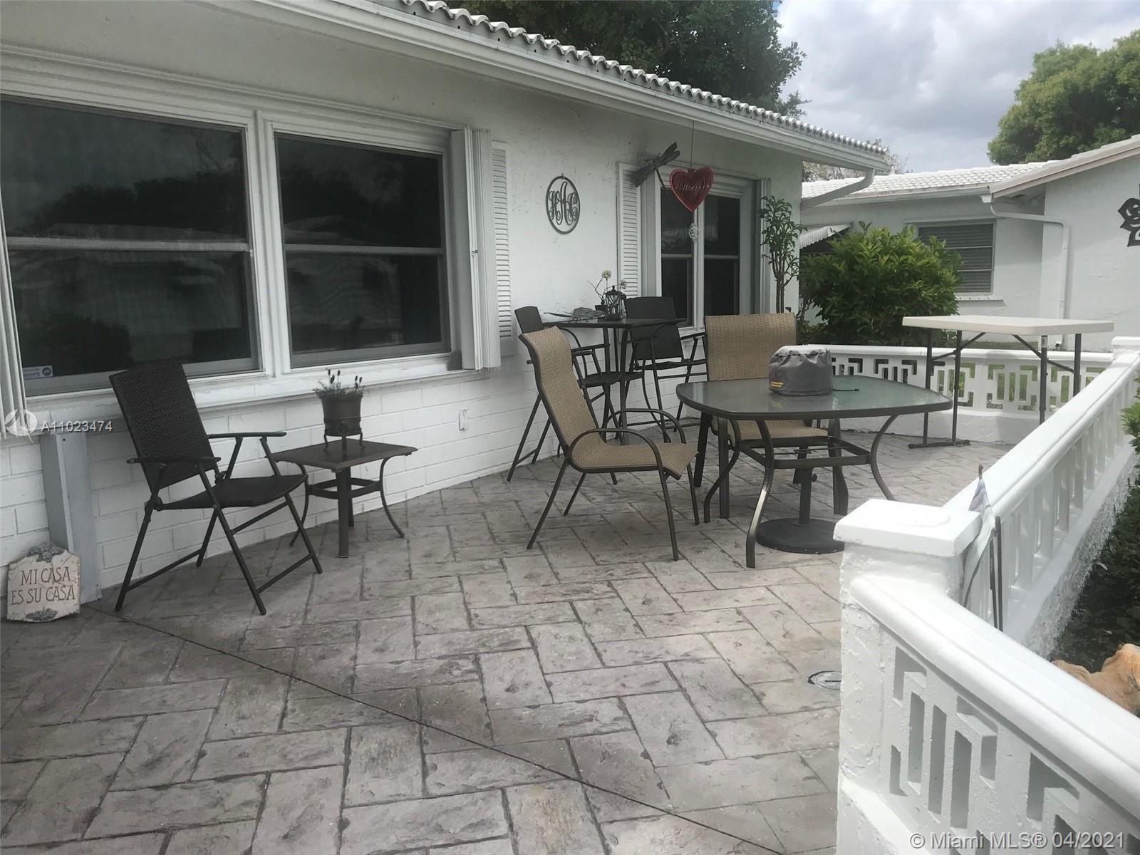 Photo of 1431 NW 85th Way, Plantation, FL 33322 (MLS # A11023474)