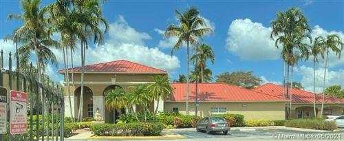 Photo of 18304 NW 68th Ave #M, Hialeah, FL 33015 (MLS # A11040475)