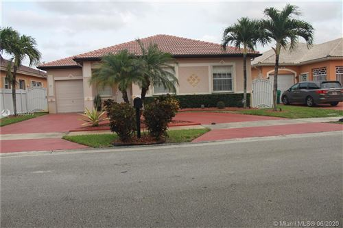 Photo of 14949 NW 92nd Ave, Miami Lakes, FL 33018 (MLS # A10880479)