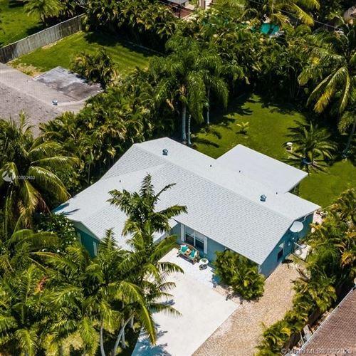 Photo of 14326 Joan Dr, Palm Beach Gardens, FL 33410 (MLS # A10860480)