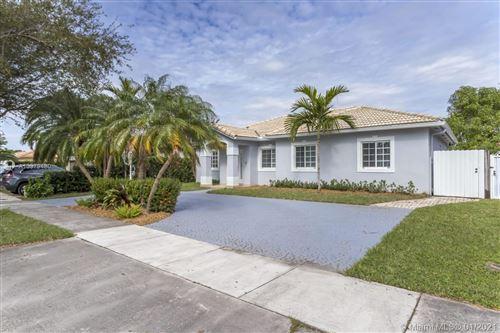 Photo of 9025 NW 164th St, Miami Lakes, FL 33018 (MLS # A10979480)