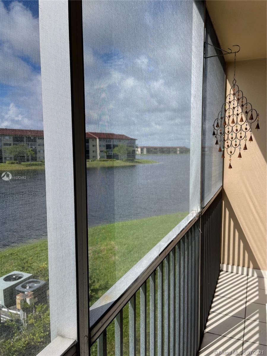 Photo of 13100 SW 11th Ct #213C, Pembroke Pines, FL 33027 (MLS # A11072482)
