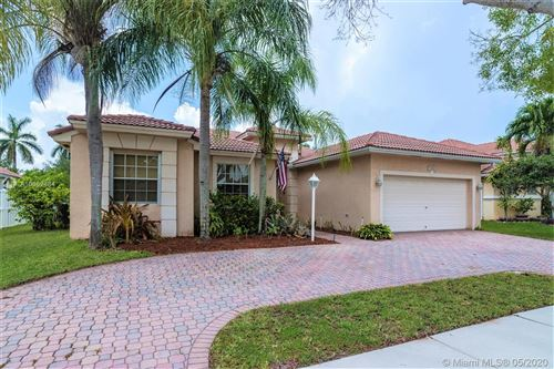 Photo of 1272 NW 141st Ave, Pembroke Pines, FL 33028 (MLS # A10862484)
