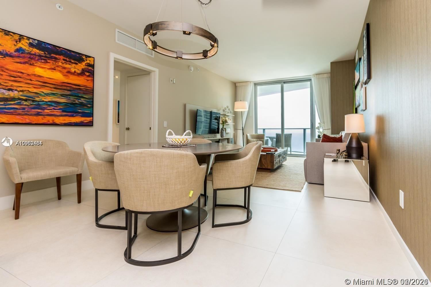 Photo of 4111 S Ocean Dr #1003, Hollywood, FL 33019 (MLS # A10962484)