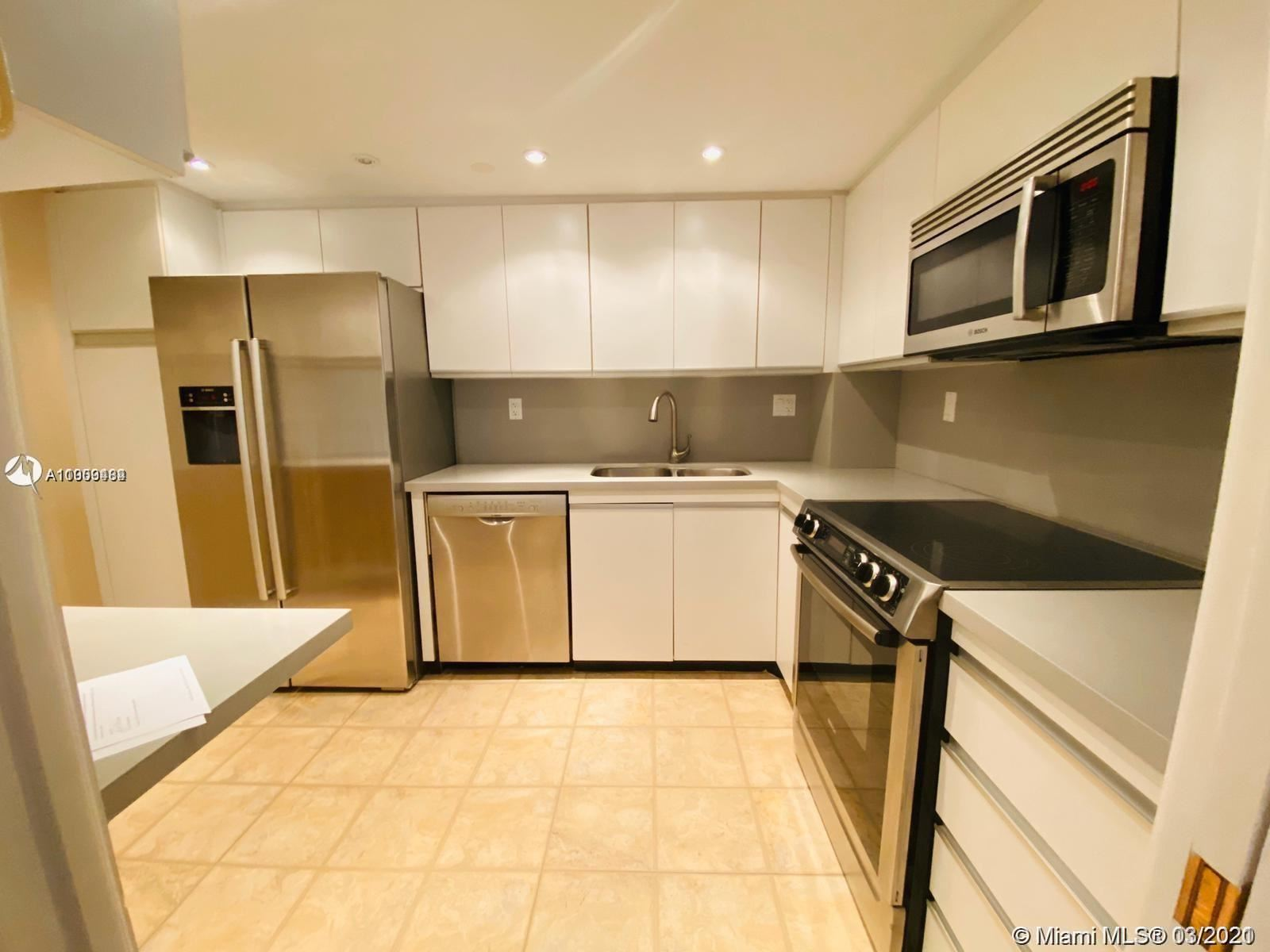 Photo of 2000 Towerside Ter #1703, Miami, FL 33138 (MLS # A11009484)