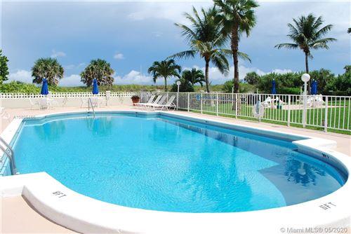 Photo of 125 Ocean Ave #202, Palm Beach Shores, FL 33404 (MLS # A10805486)