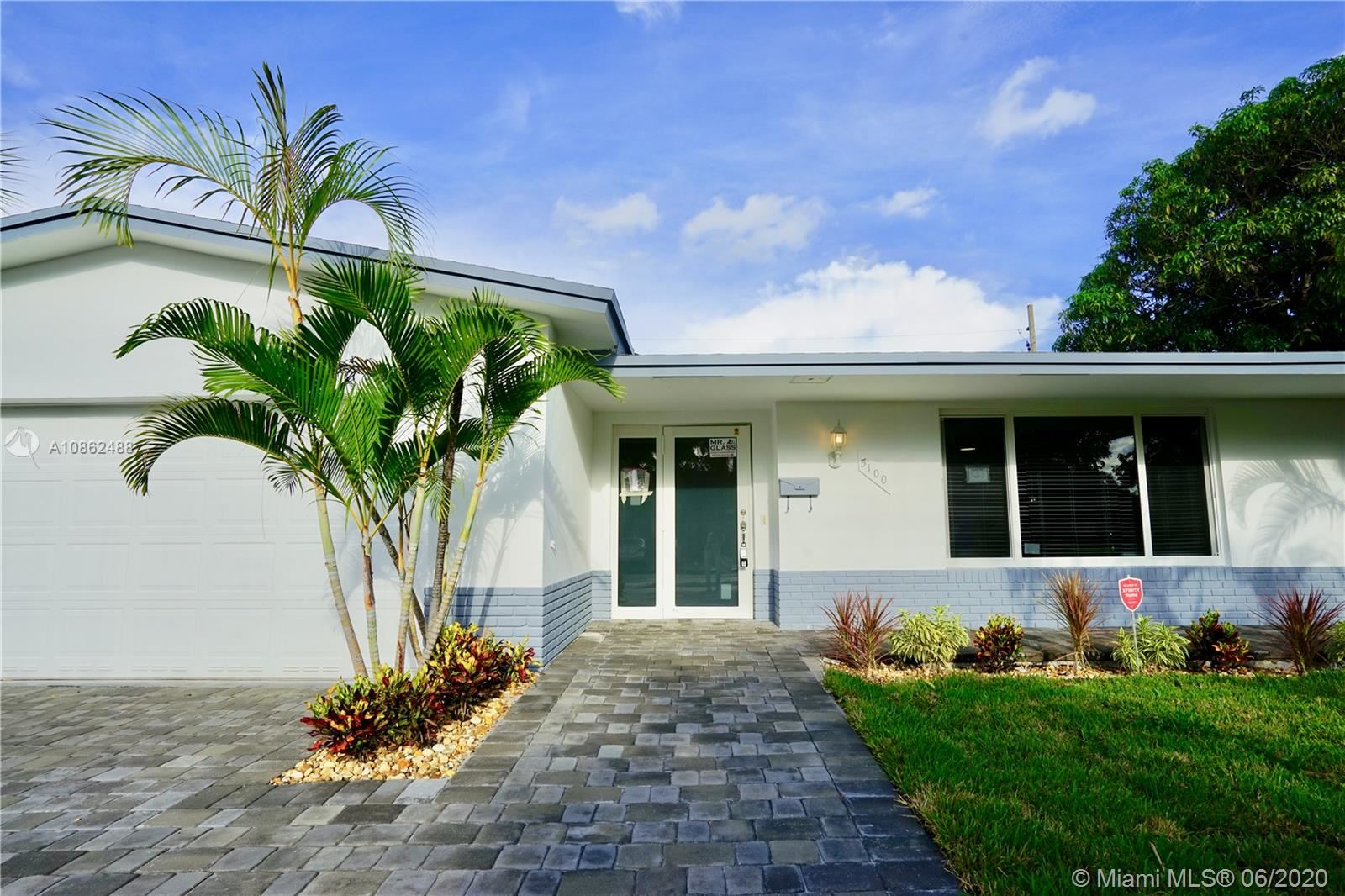Photo of 5100 NE 14th Ter, Fort Lauderdale, FL 33334 (MLS # A10862488)