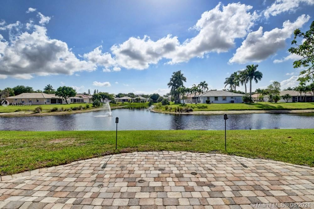 Photo of 10836 Fillmore Drive, Boynton Beach, FL 33437 (MLS # A11039489)