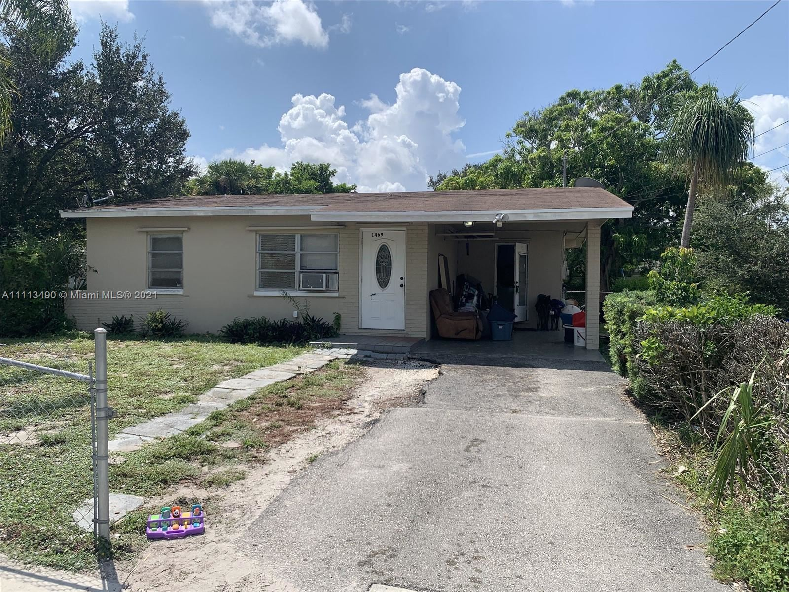 Photo of 1469 W 36th St, Riviera Beach, FL 33404 (MLS # A11113490)