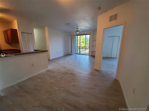 Photo of 6141 Metrowest Blvd #206, ORLANDO, FL 32835 (MLS # A10943491)