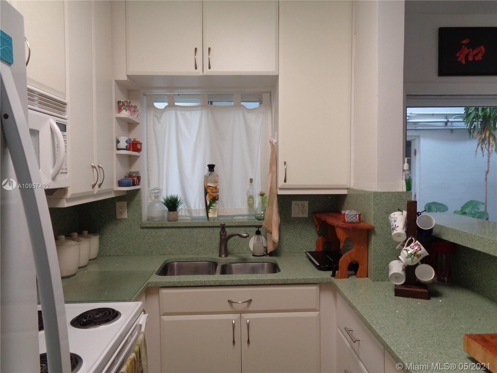 Photo of 13105 Ixora Ct #114, North Miami, FL 33181 (MLS # A10957492)