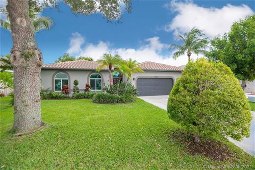 Photo of 5940 NW 72nd Ct, Parkland, FL 33067 (MLS # A11059493)