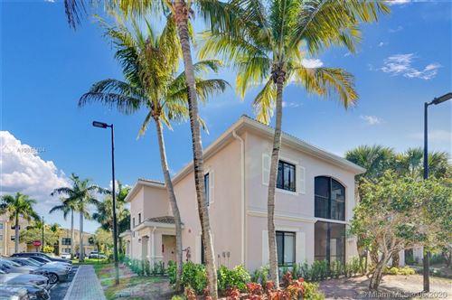 Photo of 2810 Grande Pkwy #101, Palm Beach Gardens, FL 33410 (MLS # A10853494)