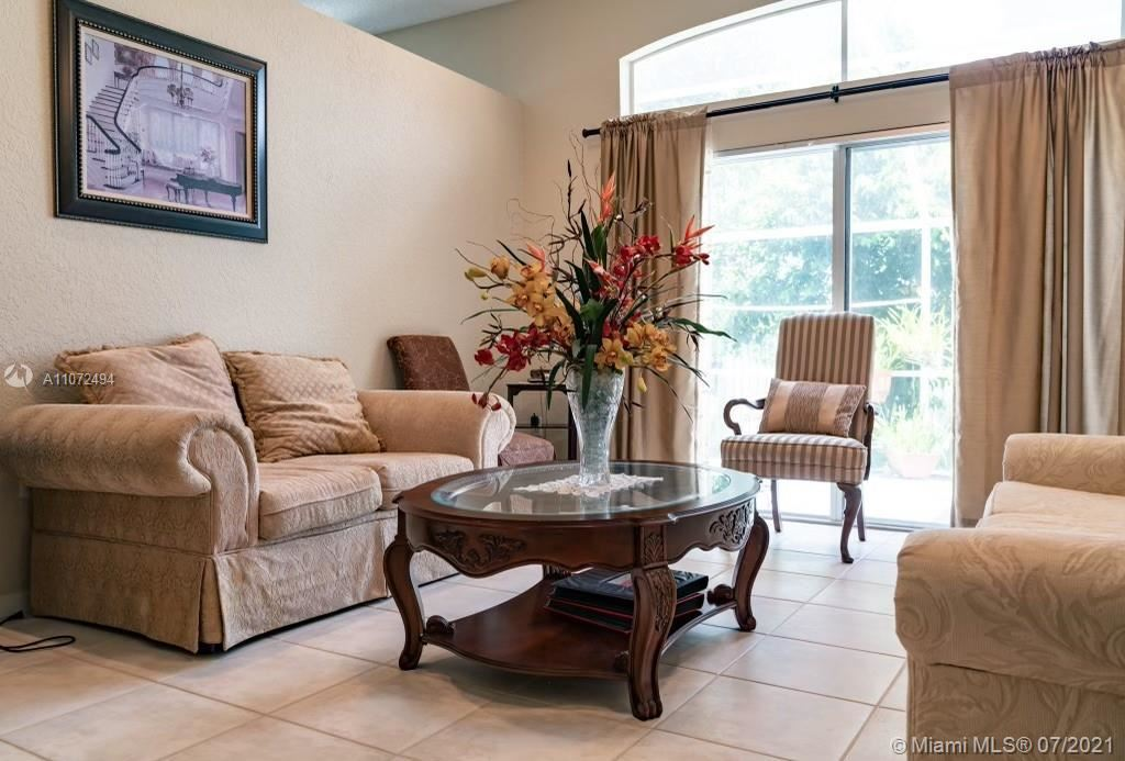 Photo of 5417 NW 48th St, Coconut Creek, FL 33073 (MLS # A11072494)