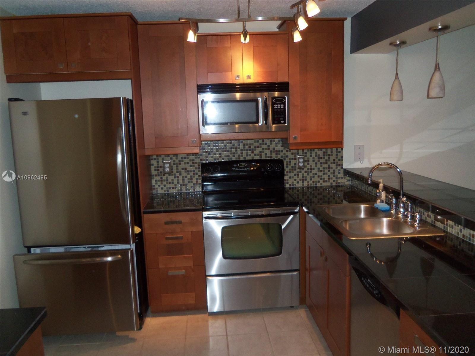 Photo of 10551 W Broward Blvd #209, Plantation, FL 33324 (MLS # A10962495)