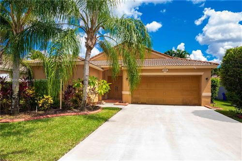 Photo of 2137 NW 142nd Way, Pembroke Pines, FL 33028 (MLS # A11097496)