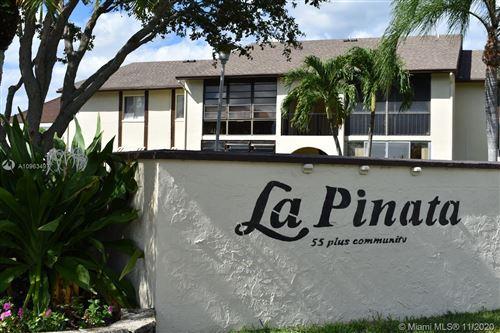 Photo of 3622 La Playas Ct #C-1, Green Acres, FL 33463 (MLS # A10963497)