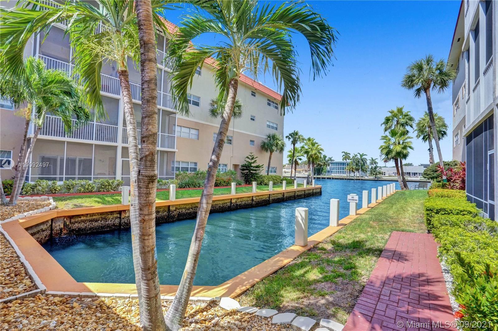 Photo of 2097 S Ocean Dr #406, Hallandale Beach, FL 33009 (MLS # A11092497)