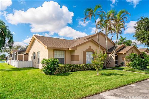 Photo of 9334 Boca Gardens Pkwy #C, Boca Raton, FL 33496 (MLS # A10959499)