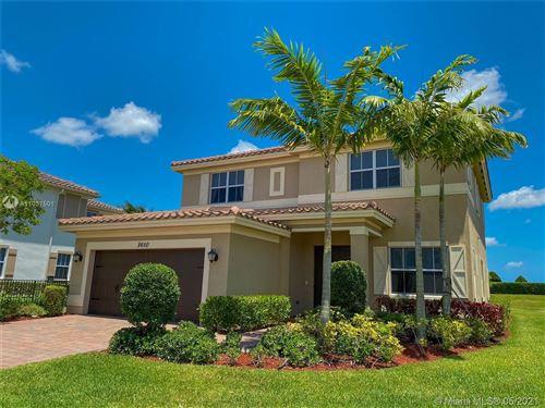 Photo of 8650 Miralago Way, Parkland, FL 33076 (MLS # A11037501)