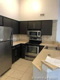 Photo of 2550 SW 18th Ter #1820, Fort Lauderdale, FL 33315 (MLS # A11101502)