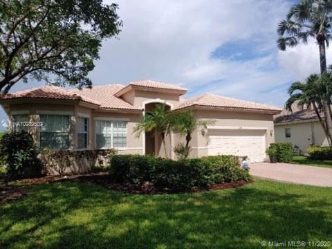 Photo of 5766 NW 50th Dr, Coral Springs, FL 33067 (MLS # A10939509)