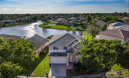 Photo of 1941 NW 169th Ave, Pembroke Pines, FL 33028 (MLS # A10841511)