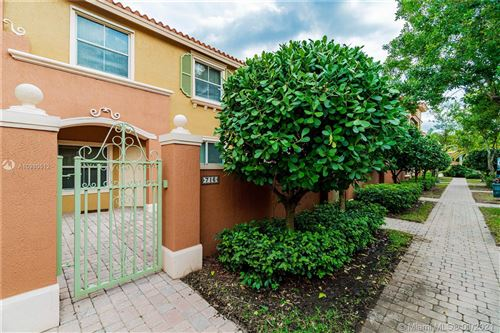 Photo of 716 SW 106th Ave #2009, Pembroke Pines, FL 33025 (MLS # A10980512)