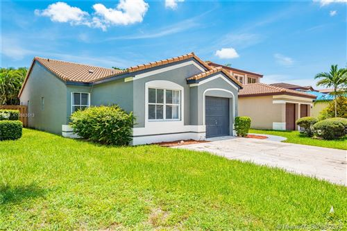 Photo of 180 NW 42nd Way, Deerfield Beach, FL 33442 (MLS # A10883513)