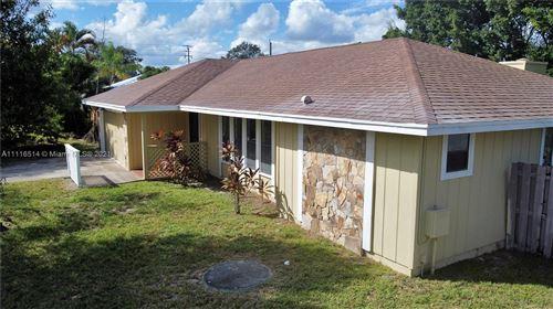 Photo of 613 SE Crescent Ave, Port Saint Lucie, FL 34984 (MLS # A11116514)