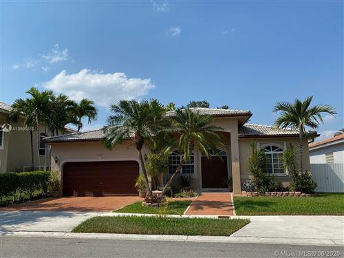 Photo of 9081 NW 145th St, Miami Lakes, FL 33018 (MLS # A10865515)