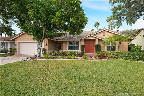 Photo of 4972 NW 105th Dr, Coral Springs, FL 33076 (MLS # A10834517)