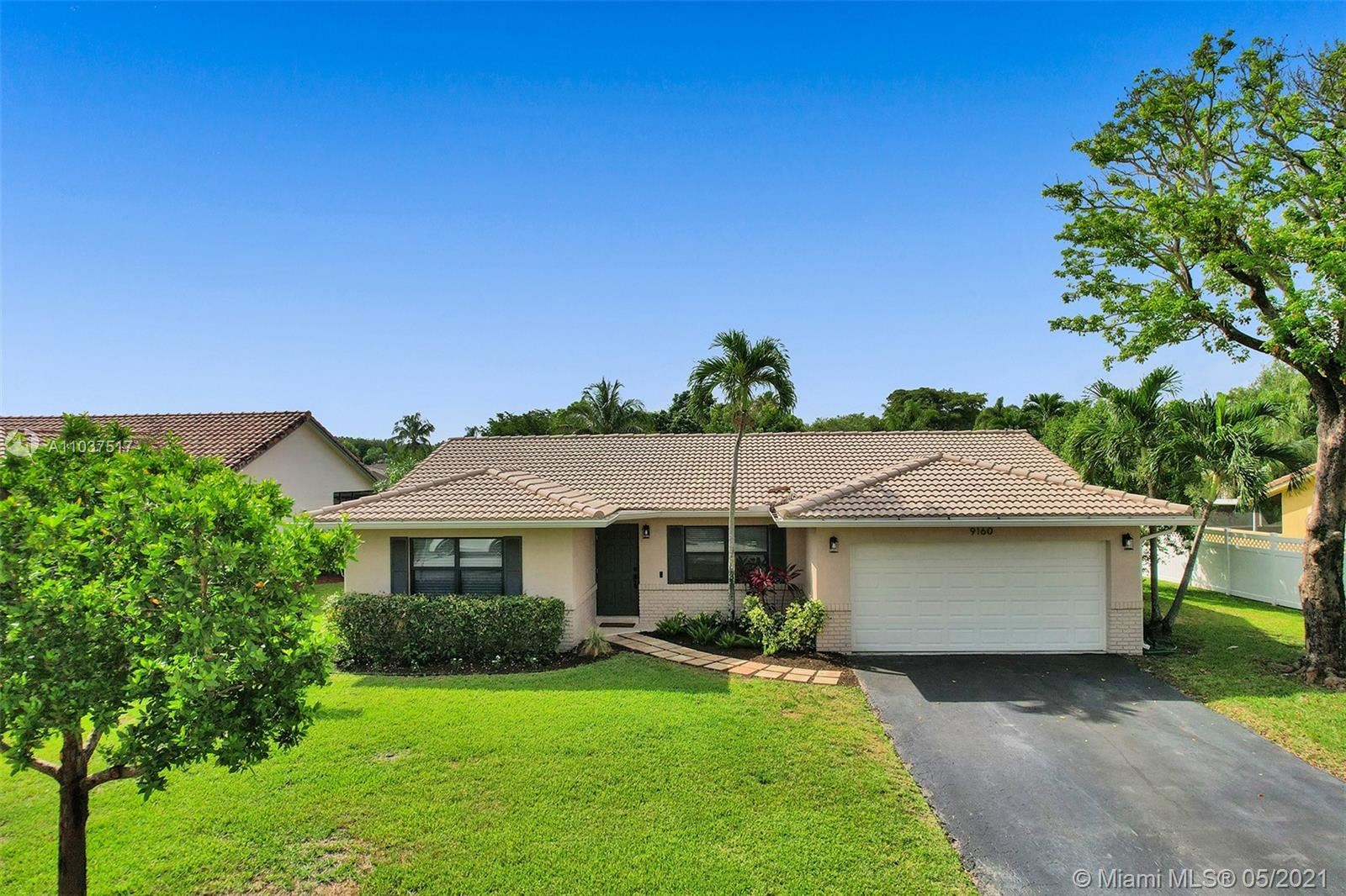 Photo of 9160 NW 21st St, Coral Springs, FL 33071 (MLS # A11037517)