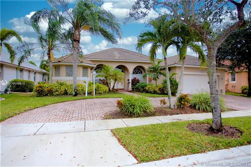 Photo of 1829 NW 139th Ter, Pembroke Pines, FL 33028 (MLS # A10983518)