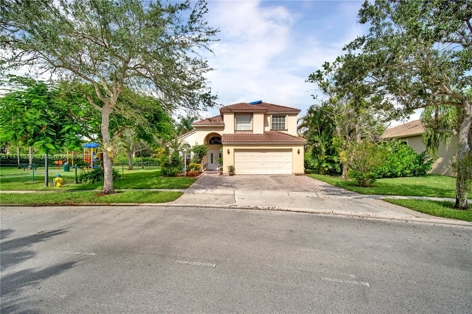 Photo of 13475 NW 12th St, Pembroke Pines, FL 33028 (MLS # A11111518)