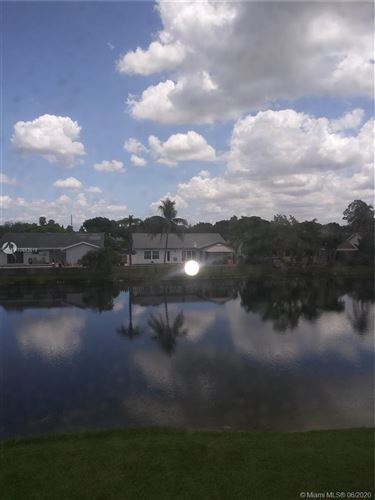 Photo of 9945 Nob Hill Ln #9945, Sunrise, FL 33351 (MLS # A10883519)