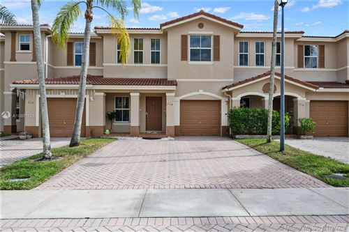 Photo of 214 Riverwalk Cir #214, Sunrise, FL 33326 (MLS # A10801521)